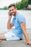 Handsome man on the phone. Royalty Free Stock Photography