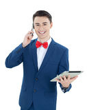 Handsome  man with phone and tablet computer. Handsome young  man with phone and tablet computer Stock Image