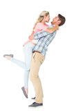 Handsome man picking up and hugging his girlfriend Royalty Free Stock Image