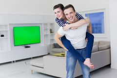 Handsome man piggybacking his girlfriend Stock Photography