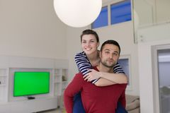 Handsome man piggybacking his girlfriend Stock Images