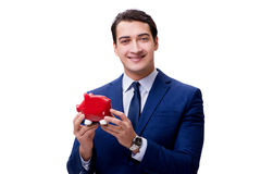 The handsome man with piggybank isolated on white Royalty Free Stock Photography