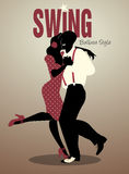 Handsome man and pin-up girl dancing swing Balboa style. Handsome man and pin-up girl dressed in 1940s clothes dancing swing Balboa style Royalty Free Stock Photography