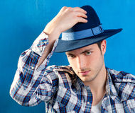 Handsome man with plaid shirt and cowboy hat Stock Photo