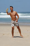Handsome man playing beach tennis Royalty Free Stock Photography
