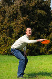 Handsome man is playing Frisbee Royalty Free Stock Images