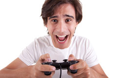 Handsome man, playing with gamepad Royalty Free Stock Images