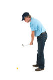 Handsome man playing golf Royalty Free Stock Images