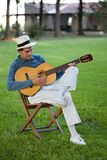 Handsome Man Playing Guitar Stock Photography