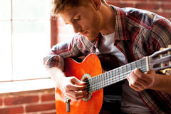Handsome man playing guitar. Royalty Free Stock Photo