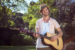 Handsome man playing the guitar Royalty Free Stock Photography