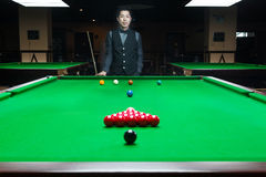 Handsome man playing snooker Stock Images