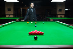 Handsome man playing snooker Stock Image