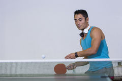 Handsome man plays table tennis Stock Photos