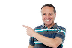 Handsome man pointing away Royalty Free Stock Image