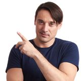 Handsome man pointing finger. Isolated stock image