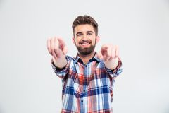 Handsome man pointing fingers at camera Royalty Free Stock Photos