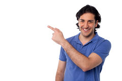 Handsome man pointing at something stock image