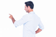 Handsome man pointing something with his finger Royalty Free Stock Photos