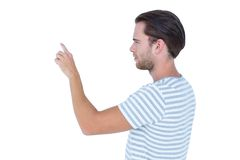 Handsome man pointing something with his finger Royalty Free Stock Image