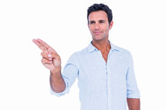 Handsome man pointing something with his fingers Stock Photos