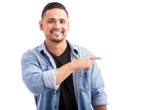 Handsome man pointing to copy space Stock Image