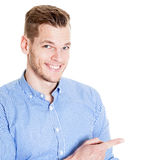 Handsome man pointing to the lateral Stock Images