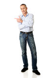 Handsome man pointing to the left Royalty Free Stock Image