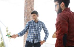 Handsome man is pointing to the whiteboard in office Royalty Free Stock Image