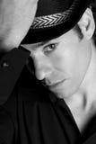 Handsome man portrait hat black and white. Handsome man portrait with hat black and white Stock Image
