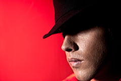 Handsome man portrait hat dark eyes mystery. Handsome man portrait with hat dark eyes mystery and beauty concept on red background Stock Images