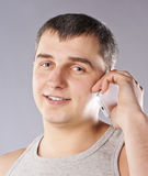 Handsome man portrait talking at the cell phone Stock Image