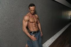 Handsome Man Poses In Modern Corridor royalty free stock photos