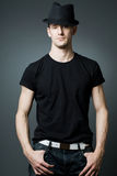 Handsome man posing in black t-shirt and bla Royalty Free Stock Photography