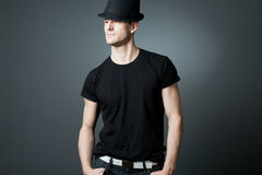 Handsome man posing in black t-shirt and bla Stock Photography