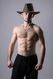 Handsome man posing with a cowboy hat Royalty Free Stock Photo