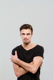 Handsome man posing with crossed arms Royalty Free Stock Photos