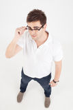 Handsome man posing with eyeglasses Stock Photography