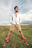 Handsome man posing on a field of grass Royalty Free Stock Images