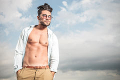 Handsome man posing with his shirt open Stock Images