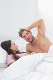 Handsome man posing next to his sleeping partner. Handsome men posing next to his sleeping partner in bed Royalty Free Stock Photography