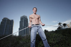 Handsome man posing with a rope Royalty Free Stock Photography