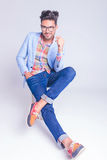 Handsome man posing seated with legs crossed Stock Photos