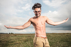 Handsome man posing without a shirt Stock Photography