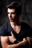 Handsome man posing in studio Stock Photo