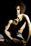Handsome man posing in studio in darkness Stock Photo