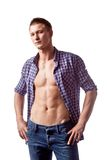 Handsome man posing with unbuttoned shirt Royalty Free Stock Photos