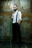 Handsome man posing in white shirt smoking hookah Stock Photo