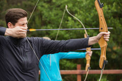 Handsome man practicing archery Royalty Free Stock Photography
