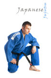 Handsome man practicing jiu-jitsu. Young handsome man practicing jiu-jitsu (Hakki Heysen Ryu school) isolated on white background Royalty Free Stock Photo